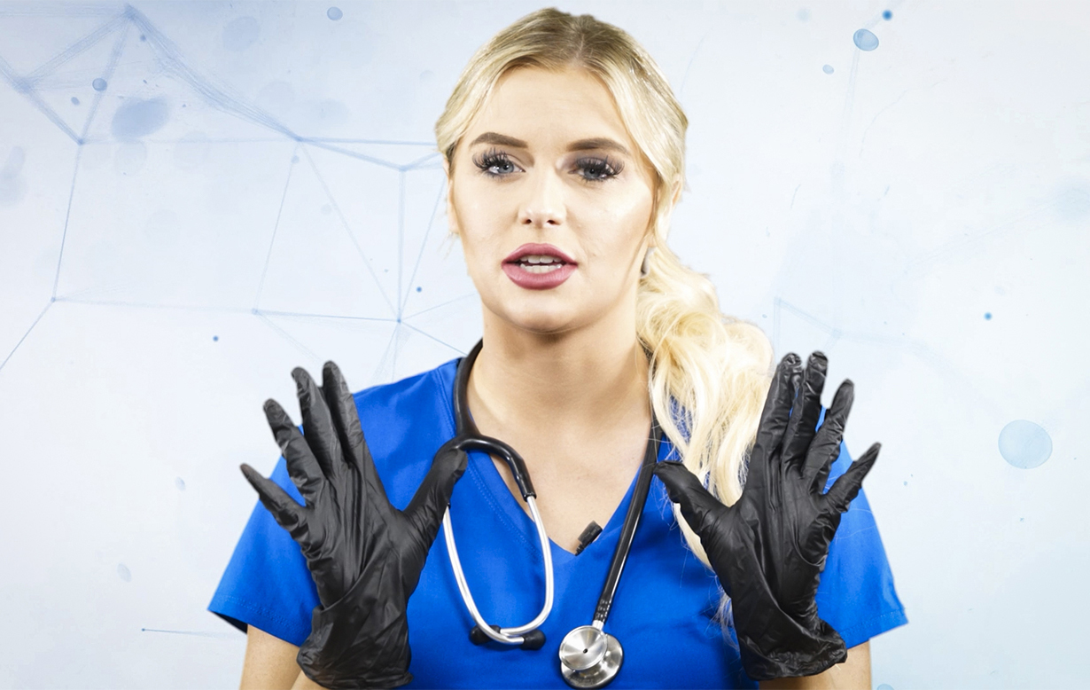 Nurse holding up gloved hands demonstrating proper personal protective equipment (PPE).